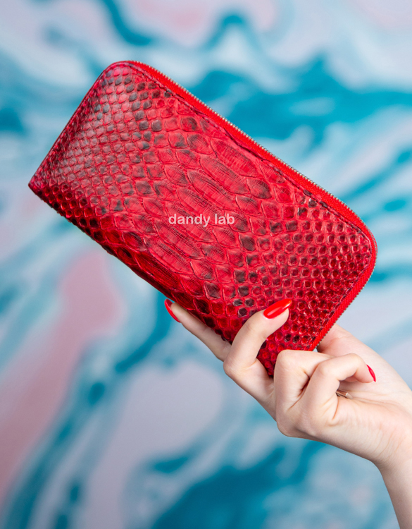 Women's wallets made of crocodile and python skin